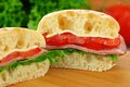 Ciabatta sandwich with ham cheese lettuce and tomato Stock Photography