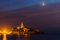 image photo : Rovinj old town at night with moon on the colorful sky, Adriatic sea coast of Croatia, Europe