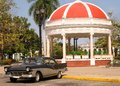 Cienfuegos square cuba plaza jose marti a city in showing bandstand and a classic car under sunny skies Stock Photo