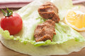 Cig kofte close up of traditional turkish appetizer raw meatballs with lemon lettuce and tomato Royalty Free Stock Images