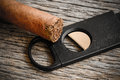 Cigar and Cigar Cutter Royalty Free Stock Photo