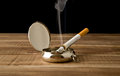 Cigarette in an ash-tray Royalty Free Stock Photo