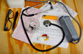 Cigarette in the ashtray and stethoscope, blood pressure monitor, pills Royalty Free Stock Photo