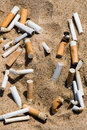 Cigarette butt in sand Royalty Free Stock Photos