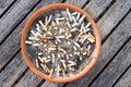 Cigarette butts in the ashtray on wood table background. The concept of World No Tobacco Day in 31 May, stop smoking, do not smoke Royalty Free Stock Photo