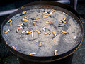 Cigarette butts in a outdoor ashtray container Royalty Free Stock Photography