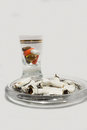 Cigarette butts and pills in glass the best for addictions smoking addiction to medication health issues Royalty Free Stock Photo
