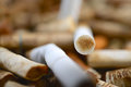 Cigarette filter with nicotine close up Stock Photos