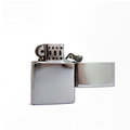 Cigarette lighter metal flip lighter a shiny open open isolated on white Stock Photography