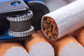 Cigarette and lighter tobacco in cigarettes close up Royalty Free Stock Photo