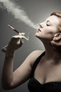 Cigarette smoking retro woman a classic beauty a Royalty Free Stock Image