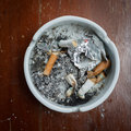 Cigarette stub in ashtray, image no smoking concept Royalty Free Stock Photo