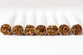 Cigarettes arranged in a row, a background Royalty Free Stock Photo