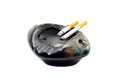 Cigarettes burns and ashtray isolated on white background Royalty Free Stock Photography
