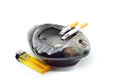 Cigarettes burns and ashtray with yellow lighter isolated on white background Royalty Free Stock Photo