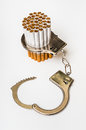 Cigarettes and handcuffs - smoking addiction concept Royalty Free Stock Photo
