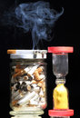 Cigarettes and hour glass Royalty Free Stock Images