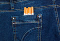 Cigarettes in jeans pocket blue Stock Image