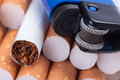 Cigarettes and lighter tobacco in close up Stock Photos