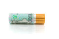 Cigarettes and money on a white background close-up Stock Photography