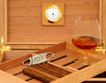 Cigars in open humidor cigar cutter glass of cognac Stock Photos