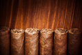 Cigars on wooden background closeup view Royalty Free Stock Images