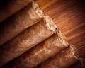 Cigars on wooden background closeup view Royalty Free Stock Photo