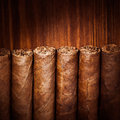 Cigars on wooden background closeup view Royalty Free Stock Photos