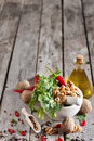 Cilantro and walnuts in a mortar red hot pepper white ceramic on wooden table copy space background Stock Photo