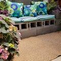 Cinder block patio bench with pillows