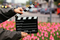 Cinema clapper board in the hands of boy Royalty Free Stock Images