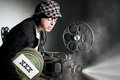 Cinema crazy projectionist shows new film Royalty Free Stock Photo