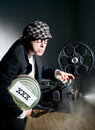 Cinema crazy projectionist shows new film Royalty Free Stock Photography