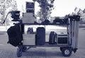 Cinema equipment transport flight cases camera tripod and Royalty Free Stock Photos