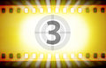 Cinema film strip with movie countdown and light rays. Movie startup concept Royalty Free Stock Photo