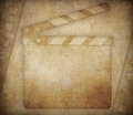 Cinema grunge background with clapperboard Royalty Free Stock Photos