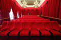 Cinema hall with chandeliers and rows of seats large beautiful red curtains Stock Photos