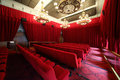 Cinema hall with chandeliers and rows of seats large beautiful red soft Royalty Free Stock Photo