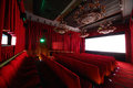 Cinema hall with chandeliers and seats large beautiful rows of soft Royalty Free Stock Photos