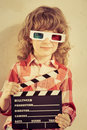 Cinema kid holding clapper board in hands concept retro style Royalty Free Stock Photography