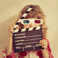 Cinema kid holding clapper board in hands concept retro style Royalty Free Stock Images