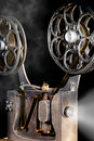 Cinema movie projector with the film Royalty Free Stock Image