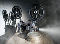 Cinema movie projector with the film on the table Stock Images