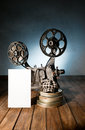 Cinema movie projector with the film on the wooden floor Royalty Free Stock Image