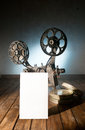 Cinema movie projector with the film on the wooden floor Stock Photo