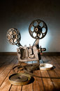 Cinema movie projector with the film on the wooden floor Stock Photos
