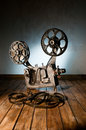Cinema movie projector with the film on the wooden floor Royalty Free Stock Photo