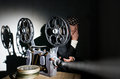 Cinema projectionist and film projector with film Royalty Free Stock Photography