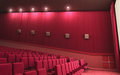 Cinema stage d render sound system spectacular lighting upholstered in red fabric Stock Images