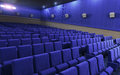 Cinema stage seats d render blue sound system spectacular lighting upholstered in red fabric Royalty Free Stock Image